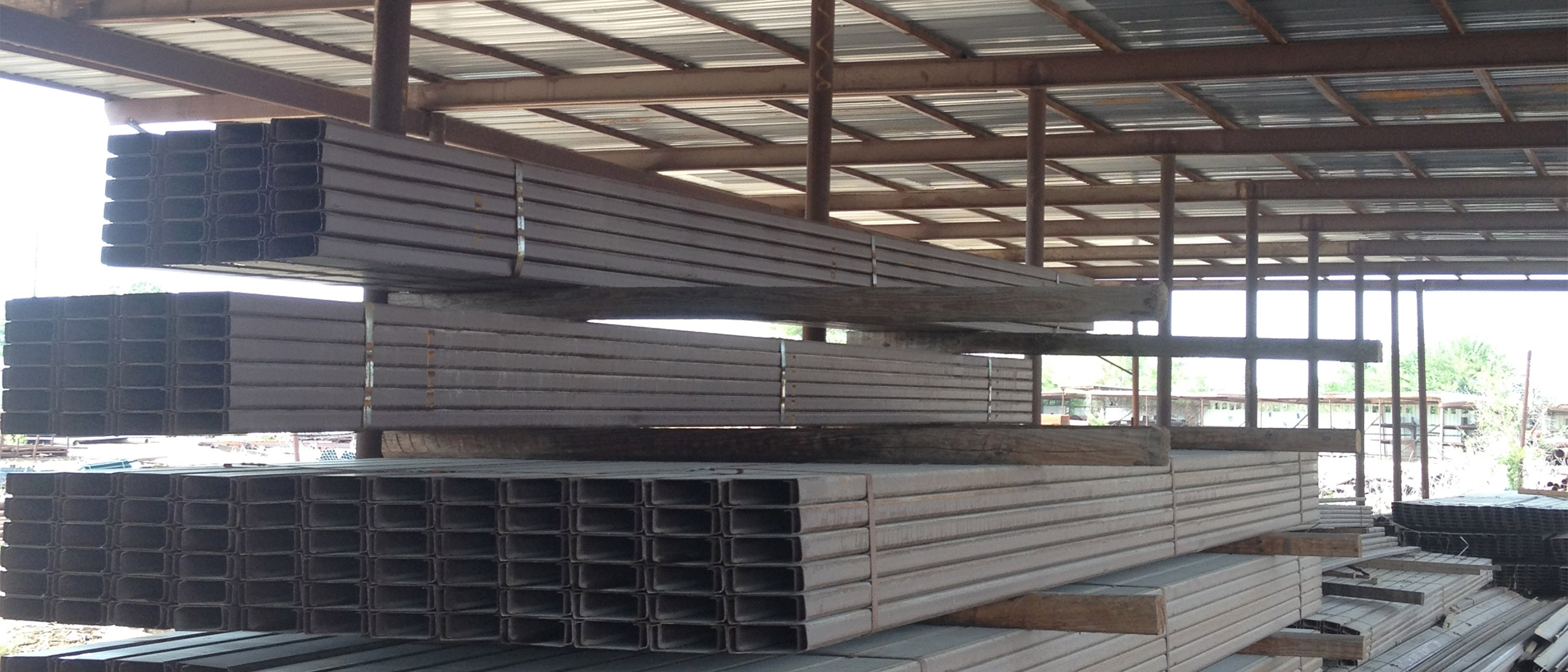 A picture of steel cee-purlin stacked up outside, metals sold by Lowery's Wholesale in Wise County, La Salle County and Reagan County, TX.