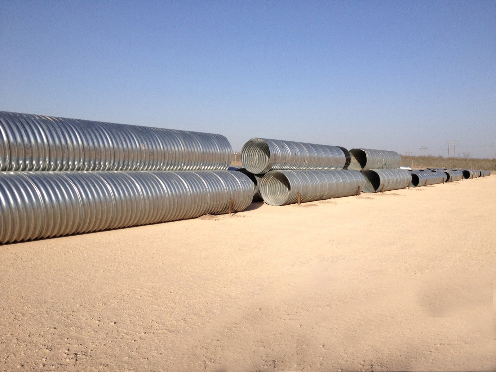 Steel culverts in the yard for sale by Lowery's wholesale in Wise County, Cotulla and Big Lake, TX.